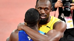 Bolt and Gatlin embrace after the race.