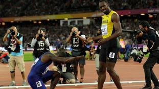 Gatlin bows down to Bolt after beating him in the 100m final.