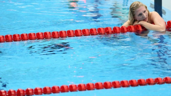 Swimmer Rebecca Adlington shows her dejection after finishing third in the Olympic women's 800m freestyle final