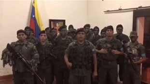 Venezuelan president vows 'maximum penalty' for army base intruders