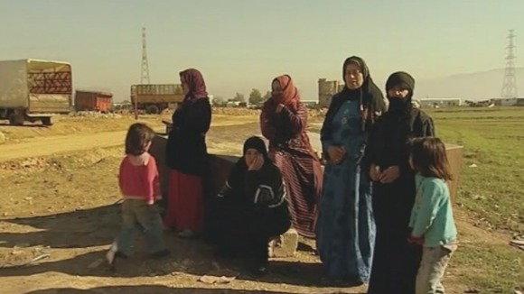 Women and children in Lebanon after fleeing Syria