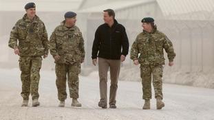 David Cameron seen walking through Kandahar Airfield in 2011