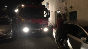 Fire engine forced to weave between parked cars