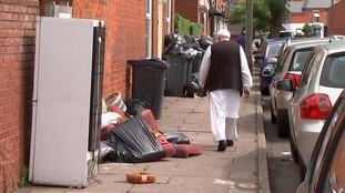 Domestic appliances and old sofas are among the uncollected refuse.