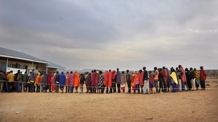 People line up outside a polling station.