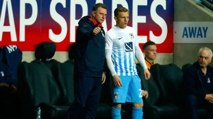 Coventry City's manager Mark Robins with George Thomas