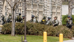 Law enforcement officers enter a hall on the Virginia Tech campus , April 16, 2007