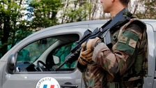 A soldier stands guard near the site of a hit and run attack in Paris
