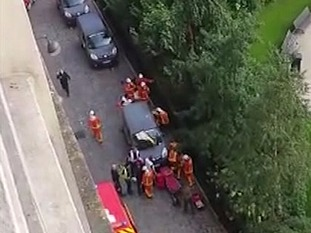 Emergency crews attend the scene of a hit and run attack against soldiers in a Paris suburb