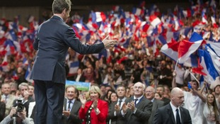 Nicolas Sarkózy arrives on stage during a political rally in Nancy