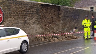 The injured man might have been working on the wall when it collapsed.