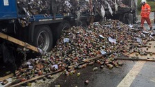 Thousands of jars of pasta sauce spilt out onto the road