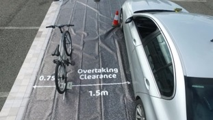 The mat supplied to police forces to help educate drivers has been supplied by Cycling UK.