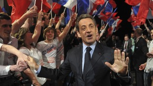 Nicolas Sarkózy greets the crowd at a political rally in Nancy