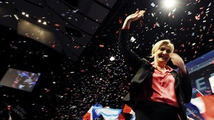 Marine Le Pen, France's National Front head waves to supporters during a rally in Nice