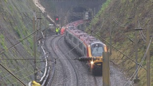 No one was hurt when the landslip cause one train to derail before it was hit by another train coming in the opposite direction.