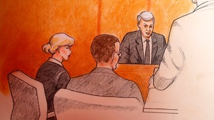 A court sketch shows Mueller testifying as Swift looks on.