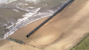 Giant pipes wash up on Norfolk beaches