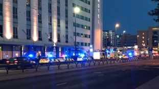 Police attend the scene of the incident in Salford, Greater Manchester