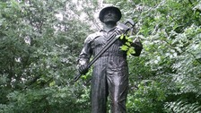 Bronze statue of the The Oil Patch Warrior which commemorates the American 'Roughnecks of Sherwood Forest'