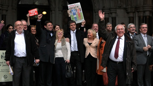 Trevor Hicks (front) waves as he comes out of the High Court in London today, with other family members and supporters.