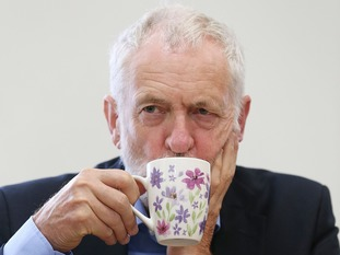 Jeremy Corbyn drinking at the Macmillan cancer morning in Bristol.