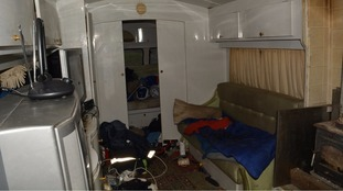 The squalid conditions inside one of the caravans the victims lived in.