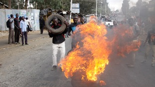 Supporters of opposition leader Raila Odinga burn tyres ahead of the results announcement.