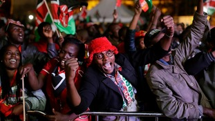 Supporters of President Uhuru Kenyatta celebrate after hearing the results.