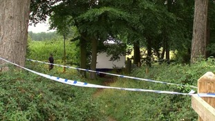 Forensic police at the scene near East Harling in Norfolk.