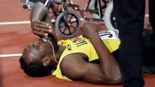Usain Bolt pulled up with an injury at the last major race of his career.