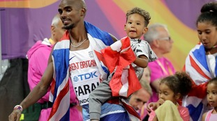 Farah leaves the track with his children after taking silver in the Men's 5000m .
