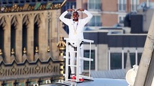 The Olympic champion struck his iconic pose on top of the 135m high wheel