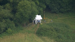 Forensic teams in the woodland.