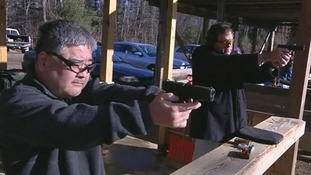 A member of a shooting range in practice