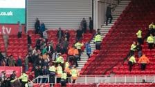 Fans clash in the stands during the Sky Bet Championship match at the Riverside Stadium