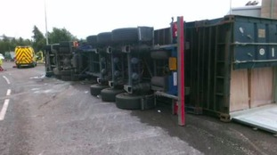 Driver suffers 'potentially serious injuries' after lorry overturns on roundabout