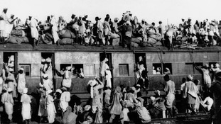 Hundreds of Muslim refugees crowd a train leaving New Delhi for Pakistan.