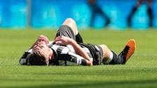 Newcastle United's Paul Dummett lies injured on the pitch.