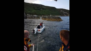 RNLI IoM rescue boat headed towards rocks