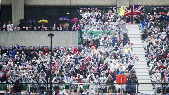Crowds watch the the Diamond Jubilee River Pageant