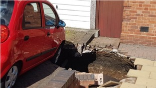 The sinkhole is now so large it has threatened to swallow a neighbour's car.