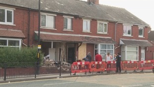 Two houses are badly damaged