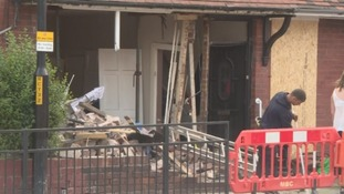 Police confirm the car that crashed into the house was being followed by a police patrol car