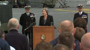 Theresa May addressed crew aboard the warship.
