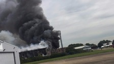 Aircraft hangar on fire at London Southend Airport