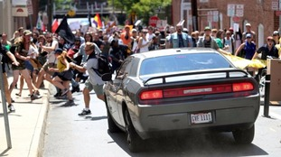 Protesters flee from a car which sped into anti-fascist protesters.