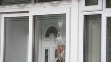 Window with bullet holes