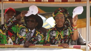 Robert Mugabe and his wife Grace, pictured in July
