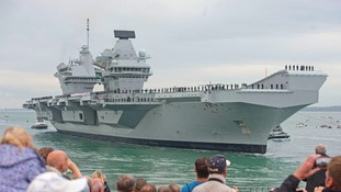 Crowds turned up before sunrise to see HMS Queen Elizabeth arrive in Portsmouth.